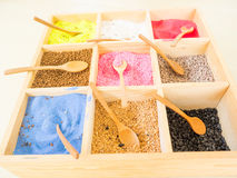 Colorful sands and rocks in wooden box Stock Photo