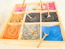 Colorful sands and rocks in wooden box Royalty Free Stock Photos