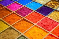 Colorful sands. In wooden box Stock Photos