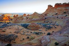Colorful sandstone buttes in the desert southwest, Utah, USA. Sunrise mesa with unique rocks glowing in the desert southwest landscape, Arizona, USA Stock Photo