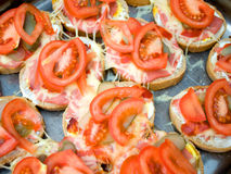 Colorful sandwich with margarine, pickles, cheese and fresh tomato Stock Image
