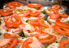 Colorful sandwich with margarine, pickles, cheese and fresh tomato Stock Photo