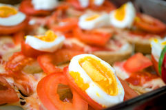 Colorful sandwich with margarine, pickles, cheese, tomato and boiled eggs Stock Image