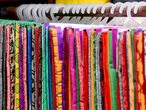 COLORFUL SAREES. Pile of colorful cotten sarees hanging in the store stock photos