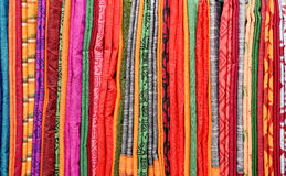 COLORFUL SAREES. Pile of colorful Ssarees in the store stock photography