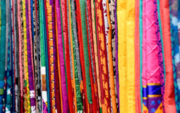 COLORFUL SAREES. Pile of colorful Ssarees in the store royalty free stock photos