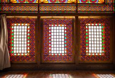 Colorful sash windows in the Arg-e Karim Khan. Shiraz, Iran royalty free stock image
