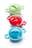 Colorful saucepans Stock Images