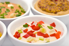 Colorful Sauces Closeup. Colorful Bright Sauces with Pepper and Onion Closeup Stock Images
