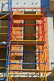 Scaffolding - raised structure of colorful metal poles and wooden boards for architecture repair), building site,. Scaffolding (raised structure of stock photography