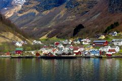 Colorful Scandinavian houses reflected in Norwegian fjord Norway. Colorful wooden Scandinavian houses reflected in tranquil surface of a Norwegian fjord in Stock Photography