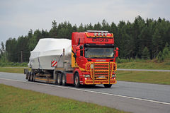 Colorful Scania R560 Hauls Boat along Motorway Royalty Free Stock Image