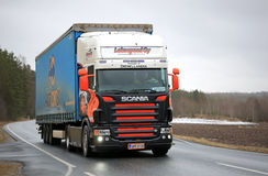 Colorful Scania V8 Semi Trailer Truck on Rural Road Stock Image