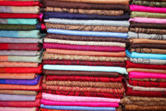 Colorful scarfs in line at market Royalty Free Stock Image
