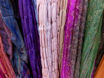 Colorful scarfs. Colorful patterned scarfs hanging up Royalty Free Stock Image