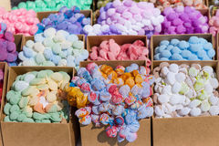 Colorful scarfs for sale in carton boxes Royalty Free Stock Images