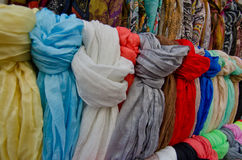 Colorful scarfs for sale in street market; Tossa de Mar, Costa B Stock Photo