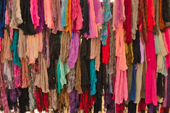 Colorful scarves. Stand with beautiful and colorful scarves for selling Royalty Free Stock Images