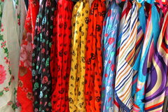 Colorful fabric and scarves. Beautiful colorful silks exposed outdoor Stock Image