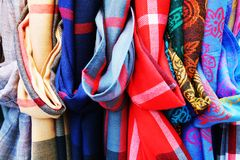 Colorful scarves background and texture. Colorful textile scarves background in blue, red, grey and beige hues Royalty Free Stock Image