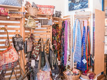 Colorful scarves and bags on display at Art House Center Stock Photos