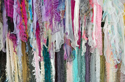 Colorful scarves on display. Colorful assortment of scarves on display Stock Images