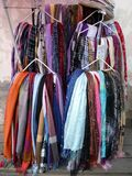 Colorful Scarves on Hangers For Sale Stock Image
