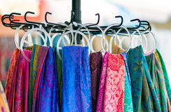 Colorful scarves hanging in the market Royalty Free Stock Photos