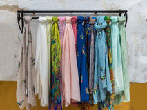 Colorful scarves on Iron Hanger in a Store.  Royalty Free Stock Photos