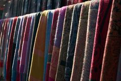 Colorful scarves at a market in Italy. Colors of textiles Royalty Free Stock Image