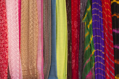 Colorful scarves at a market Stock Photo