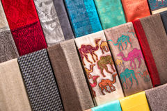 Colorful scarves at market stall. Handmade colorful Arabic scarves at textile souk, Dubai Royalty Free Stock Photography