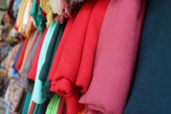 Colorful scarves in Nazareth market. Colorful scarves hanging on a stand in Nazareth market in the spring Stock Images