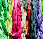 Colorful scarves on a rack Royalty Free Stock Image