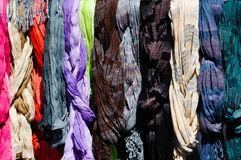 Colorful scarves on a rack Stock Images