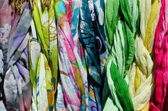 Colorful scarves on a rack Stock Photos