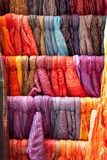 Colorful scarves in a row Stock Images