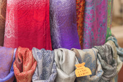 Colorful scarves. On sale in a street store Royalty Free Stock Photo