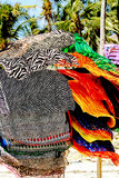 Colorful scarves. On a sandy beach in Kenya Royalty Free Stock Images
