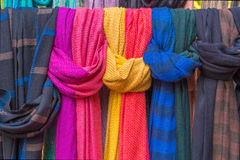 Colorful of scarves in a textiles market.  Stock Photos