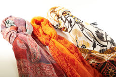 Colorful scarves on a white background Royalty Free Stock Photo