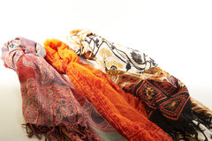 Colorful scarves on a white background Stock Images