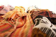 Colorful scarves on a white background Stock Photos