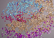 Colorful scattered sequins Stock Photos