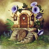 Teapot house with purple flowers. Colorful scene with a fantasy teapot house, purple flowers and green fern Royalty Free Stock Image