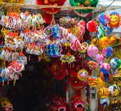 Colorful scene, friendly vendor on Hang Ma lantern street, lantern at open air market, traditional culture on mid autumn, Vietnam Royalty Free Stock Image