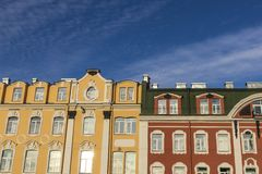 Colorful scene with old building facades on a sunny day. Blue sky and yellow red and green old restored building facades in Saint Petersburg, Russia stock image