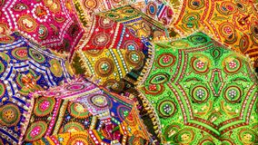 A colorful scene of ornamental parasols in India, with vibrant colors and traditional patterns. stock photo