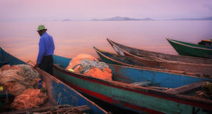 Colorful scenic sunset with fishing boats on Mfangano Island, Lake Victoria, Kenya Royalty Free Stock Photos