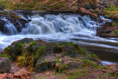 Colorful scenic waterfall in HDR Royalty Free Stock Image